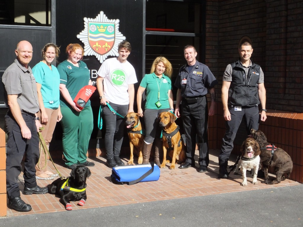 L-R Michael Shooter with K9 investigation dog Etta - K9 Investigation Lynne - Peel Veterinary Clinic Sarah - Peel Veterinary Clinic Tyler – Rhodes2safety with First Aid Training dog Axl Kerry – Rhodes2safety with First Aid Training dog Chi Chris Maughan – Project Lead Humberside Fire & Rescue Service Jon Willingham with K9 Investigation dogs Aston and Sox - K9 Investigation